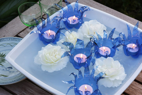 Recycling: Blue flowers from plastic bottles with tea lights in it - swimming in a bowl with water, quilted photo available Evening tinkering lighting blue flowers twilight decoration idea decoration bottle garden garden decoration idea candle candles creative creative creative idea creative idea light lights idea plastic plastic bottle recycling roses floating rose petals shell bowl floating candle floating lights themselves make homemade Summer Summer Garden Step Steps tealight tealights water white recycling